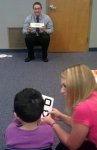 Optometry interns check a preschooler's visual acuity.