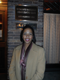 Dr. Hawthorne poses in front of the Woman's National Democratic Club sign.