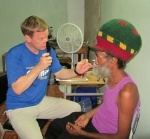 Philip Raber, O.D., examines a patient while on a volunteer trip to Jamaica.