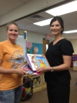 Wanda Vaughn, O.D., at right, provides ArOA books to a Head Start preschool teacher.