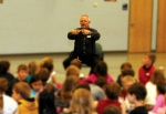 "AOA President Mitch Munson, O.D., also known as the ""Cow Eye Guy,"" explains how the eyes work to a group of second-graders in Highlands Ranch, Colo."