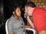Dr. La Liberte performs an exam on a young woman as part of a recent mission trip.