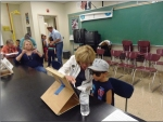 Taos Lions Club volunteers work with area children.