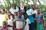 Dr. Ransom Anderson poses with some of the younger patients in Kenya.